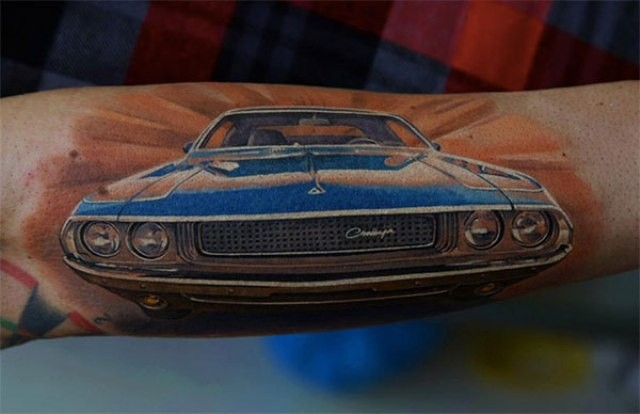 Wonderful blue car tattoo on arm
