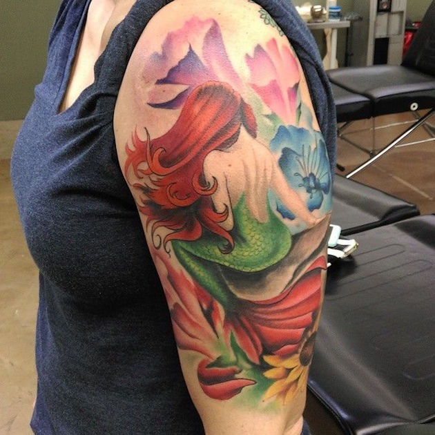 Wonderful colored and painted big mermaid tattoo on shoulder with flowers