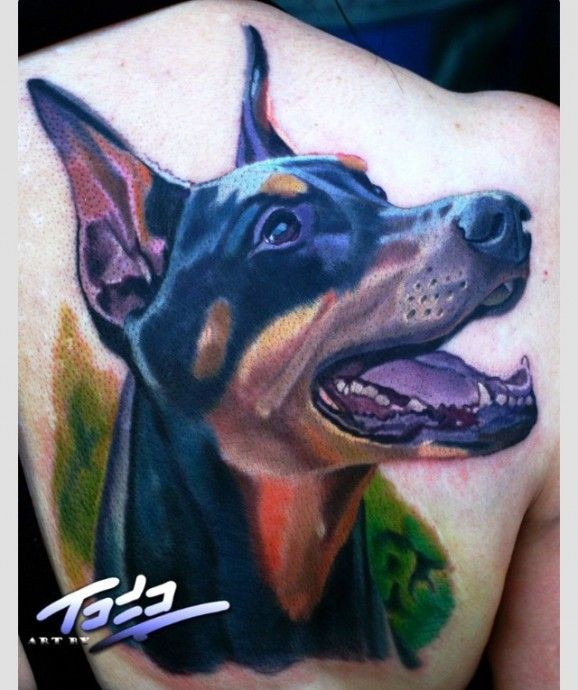 Wonderful coloured doberman tattoo