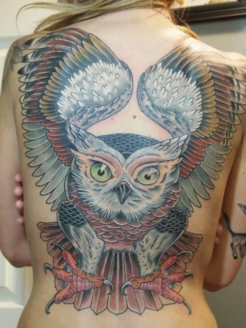 Wonderful coloured flying owl tattoo by Jason Tucker