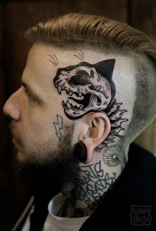 Wonderful crazy face tattoo on mans head