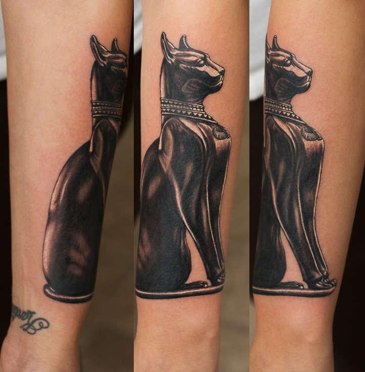 Wonderful detailed and colored little forearm tattoo of Egypt cat statue