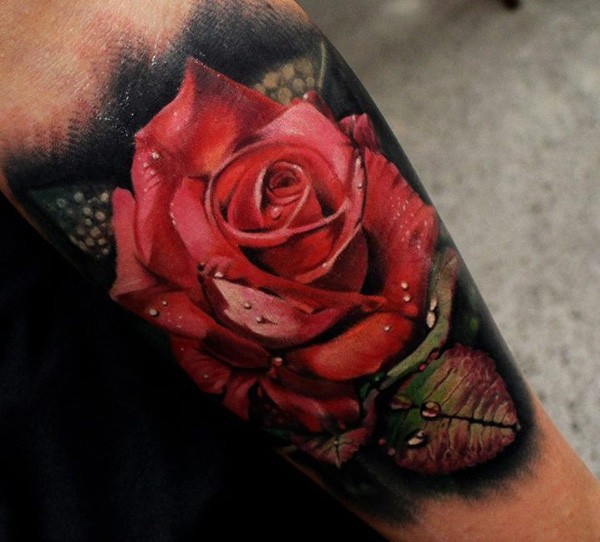 Wonderful detailed big red colored rose with water drops tattoo on leg