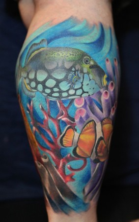Wonderful fish in ocean tattoo