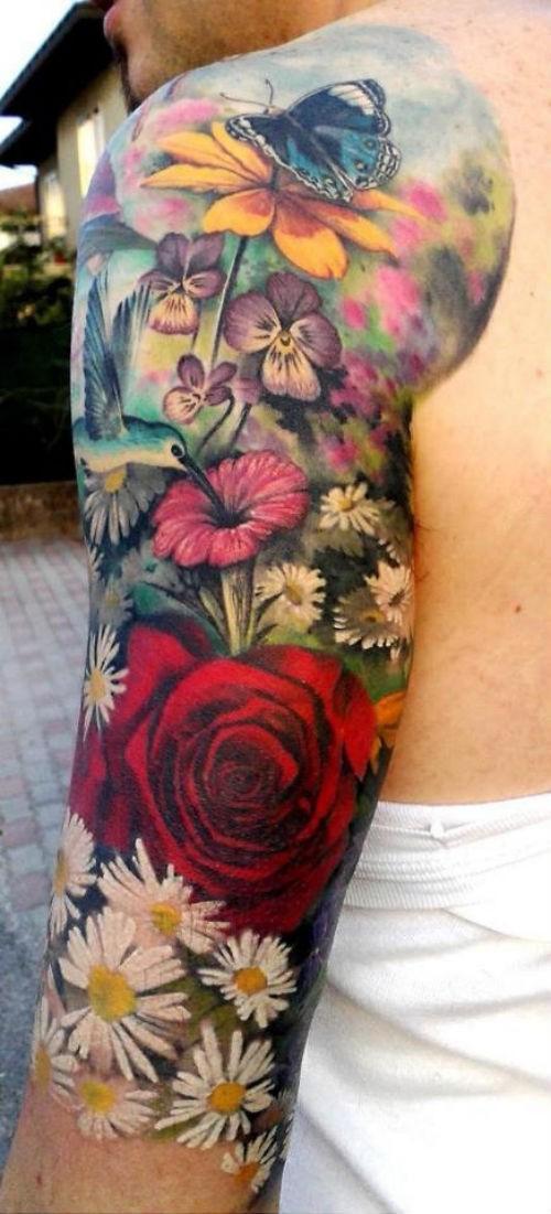 Wonderful flowers half sleeve tattoo idea