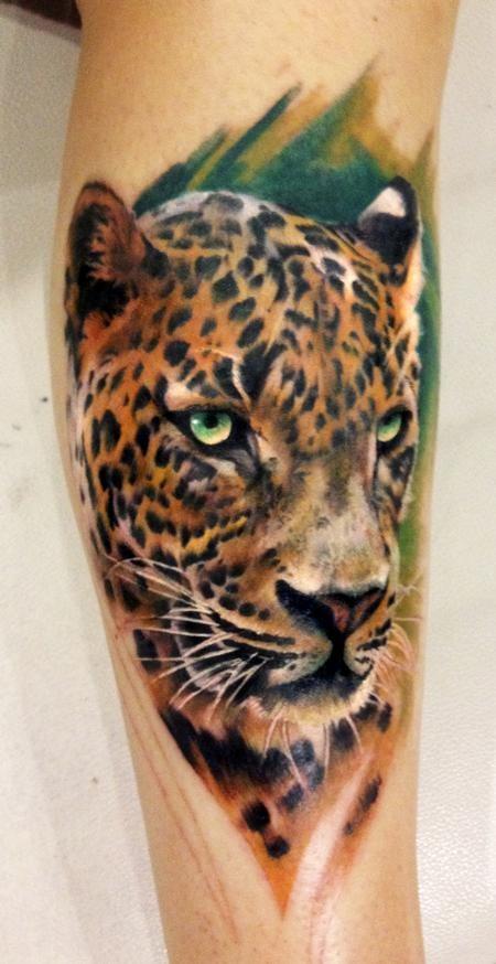 Wonderful jaguar tattoo in grass