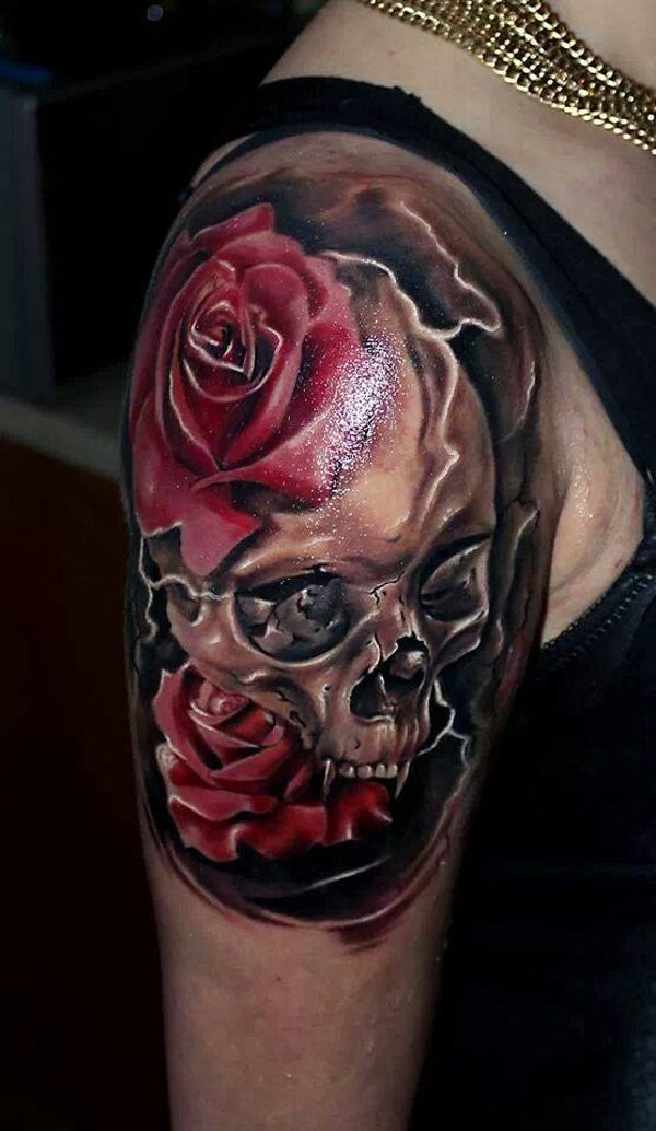 Wonderful lifelike realism style colored shoulder tattoo of human skull with rose flowers