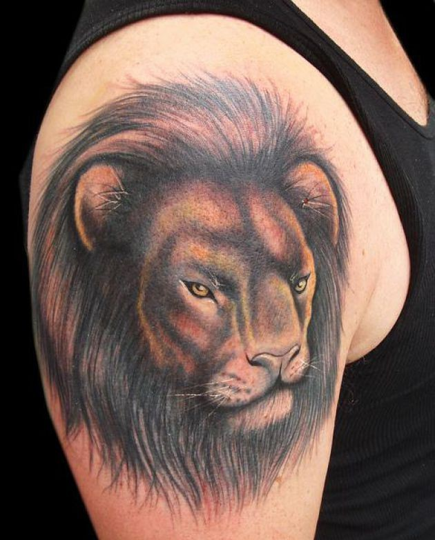 Wonderful lion face tattoo
