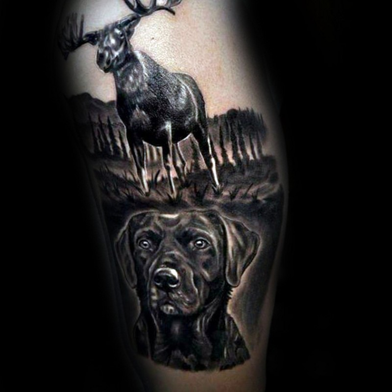 Wonderful looking black and white dog portrait tattoo on arm with big elk
