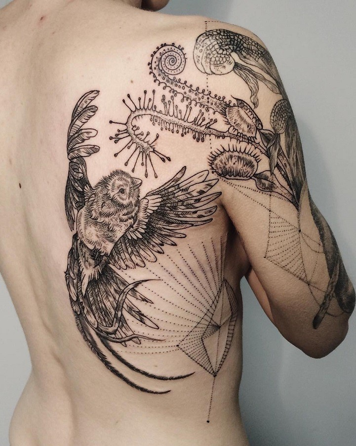 Wonderful looking black and white shoulder and back tattoo of bird with predator plants