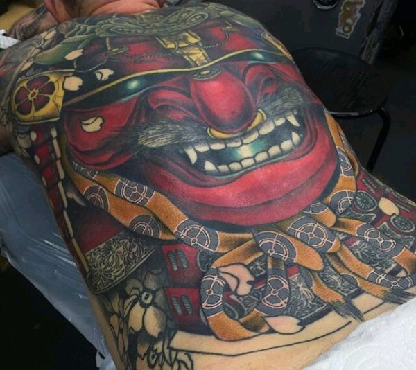 Wonderful looking detailed massive whole back tattoo of samurai warrior mask