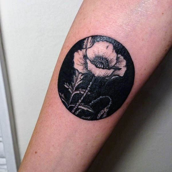 Wonderful painted black and white tattoo with little flower on arm