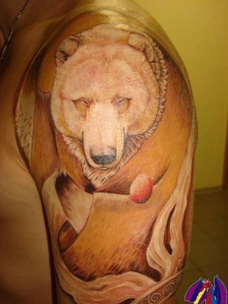 Wonderful polar bear tattoo on shoulder