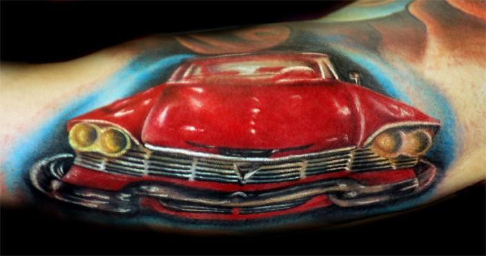 Wonderful red car tattoo on arm