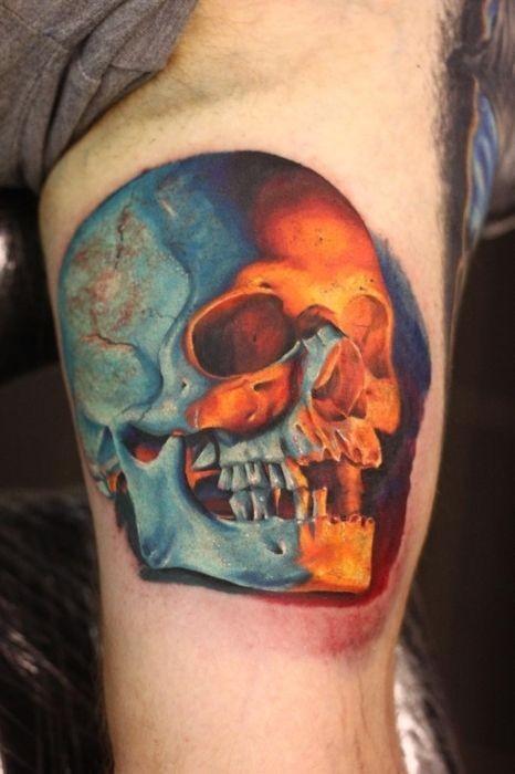 Wonderful skull lit flames tattoo on arm