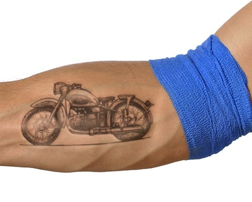Wonderful vintage motorcycle forearm tattoo