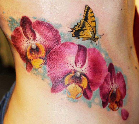 Wonderful watercolor orchids with yellow butterfly tattoo