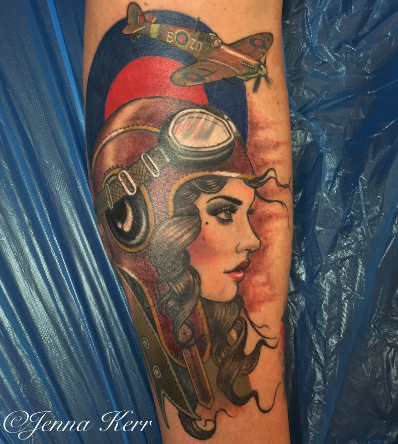 WW2 themed colored tattoo painted by Jenna Kerr of woman pilot with fighter plane