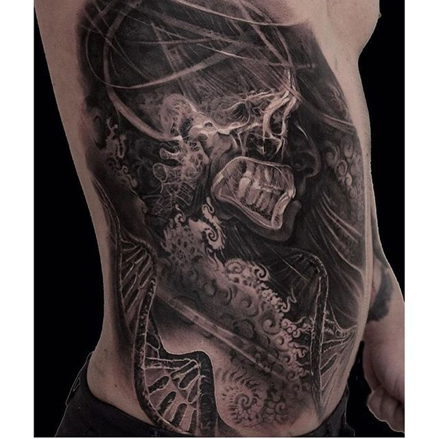 X-Ray style black ink side tattoo of human skeleton with DNA