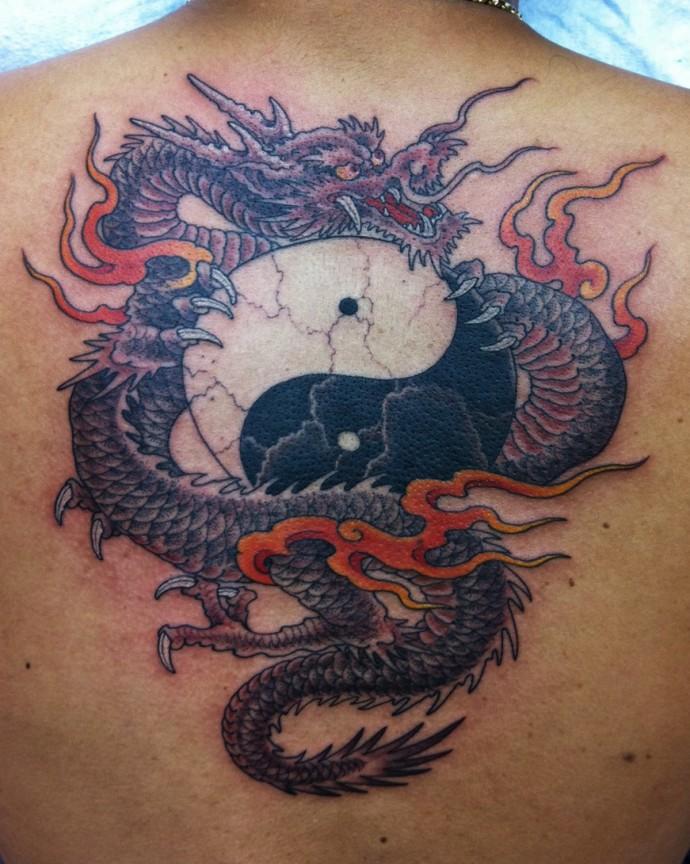 Yin yang tattoo with dragons