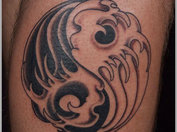 Yin yang wave tattoo