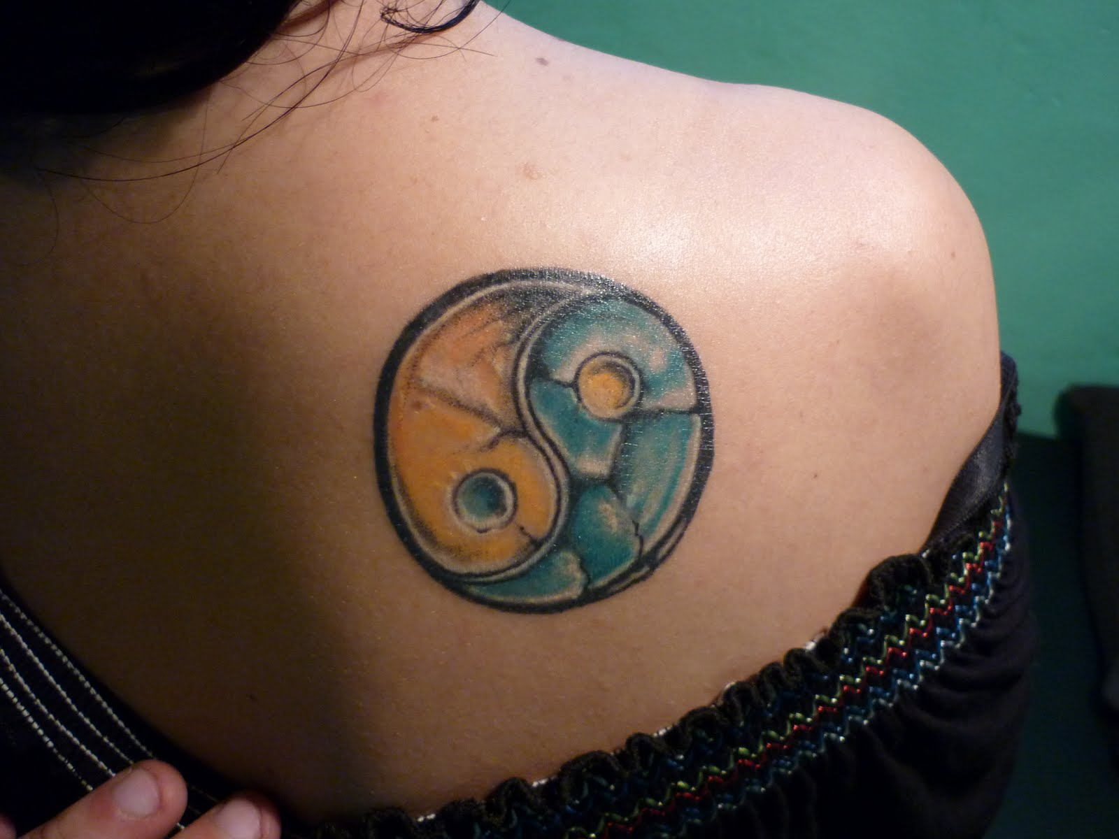 Ying and yang chinese symbol tattoo