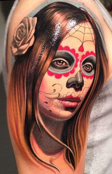 Young cute santa muerte girl tattoo