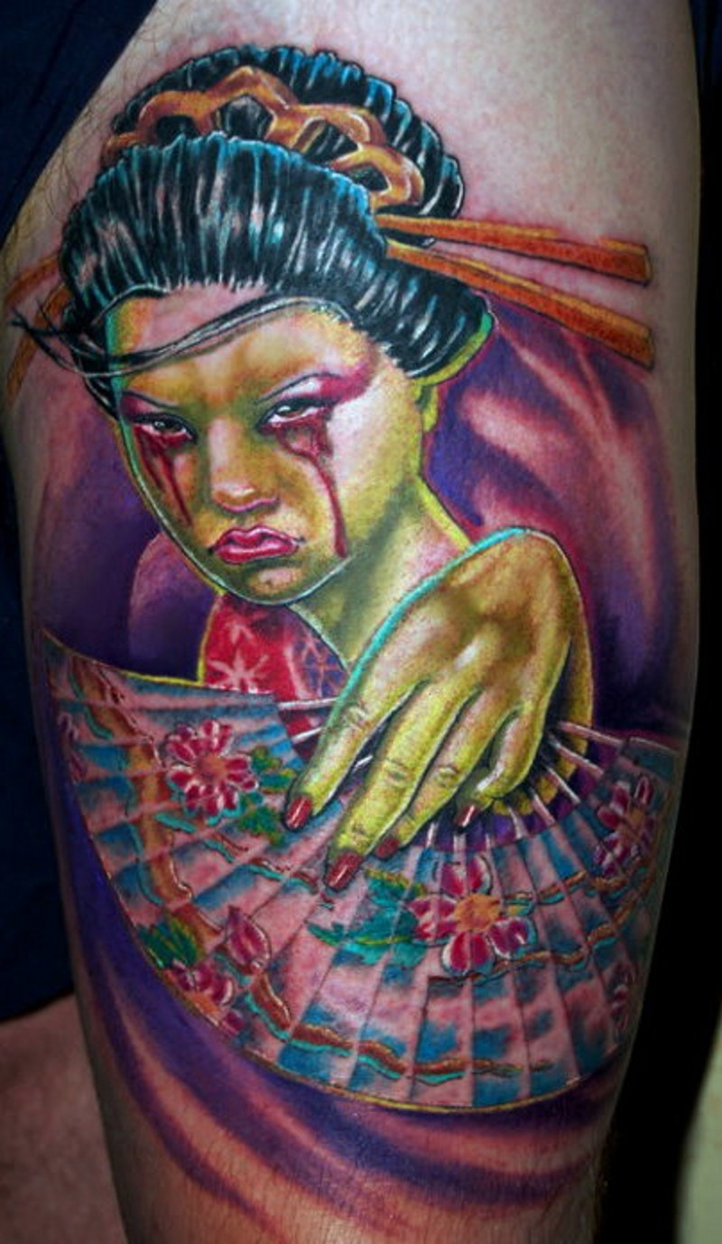 Zombie like colorful crying Asian woman tattoo on thigh with fan