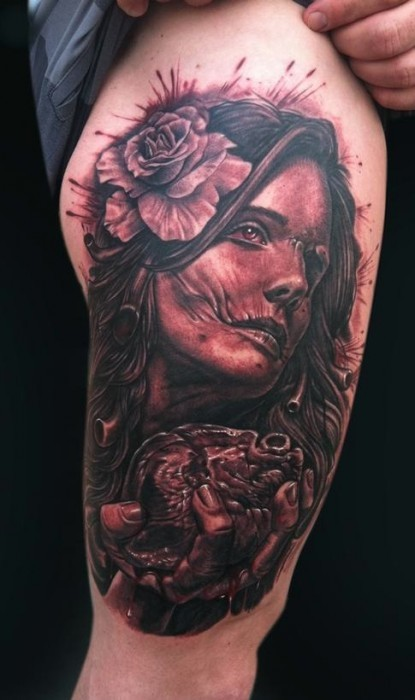 Zombie like very detailed gypsy woman with flower and heart tattoo on thigh